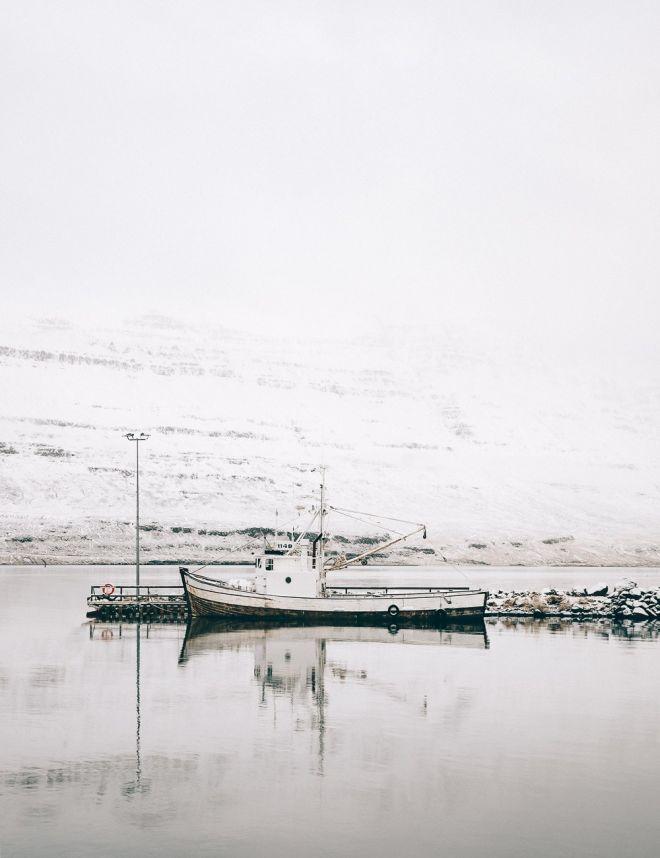 Fishing boat in Seydisfjordur, Iceland - minimalist winter photography