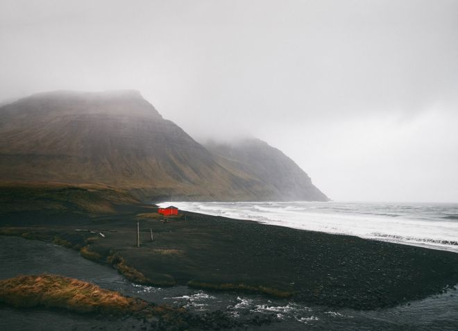 Iceland landscape photography - red cabin on a black sand beach